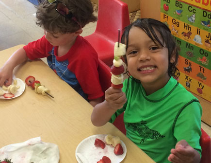 Kids Eating Healthy Fruit on a Stick