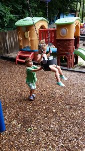 Kid Pushing Another Kids on Swing